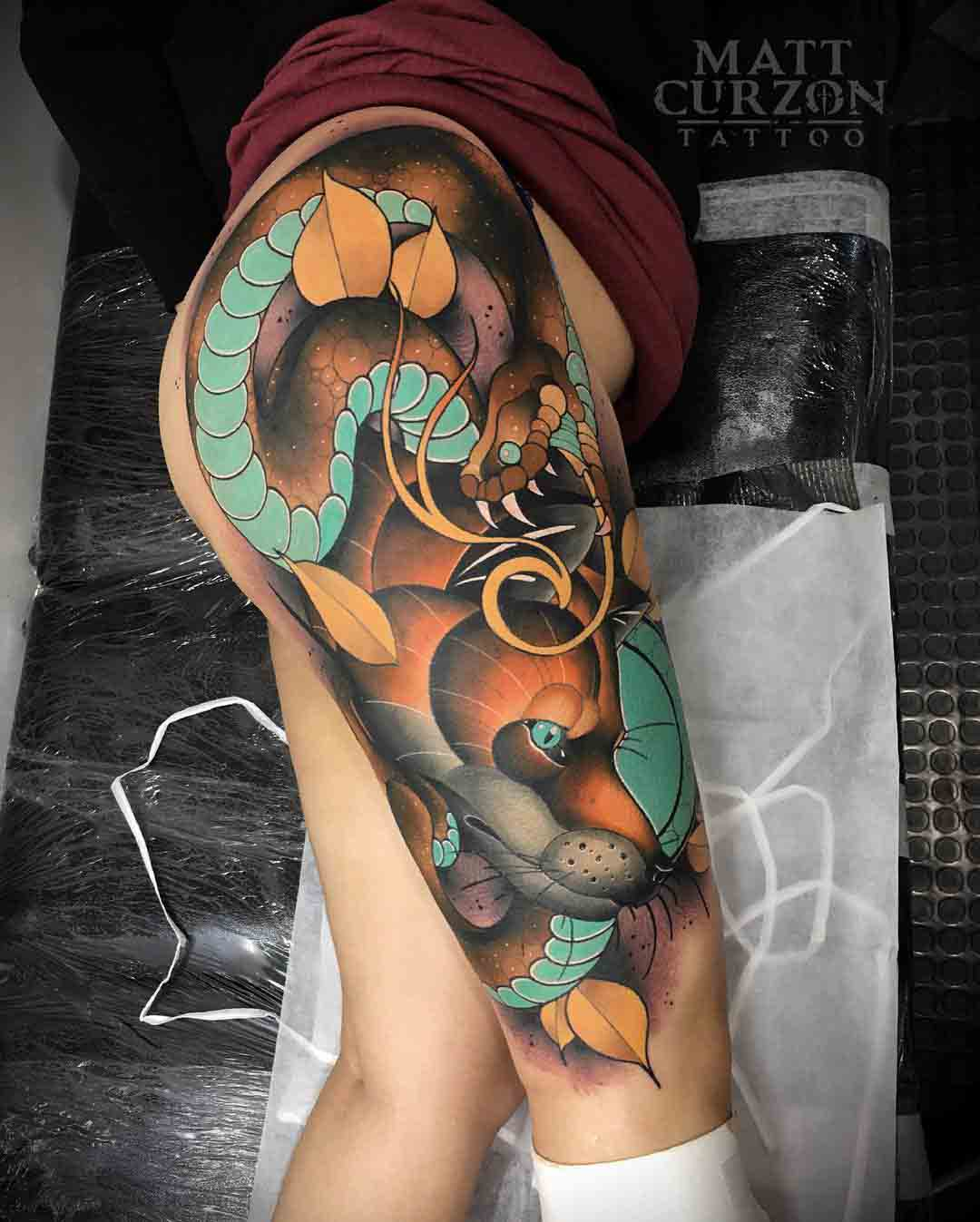snake and fox tattoo on hip