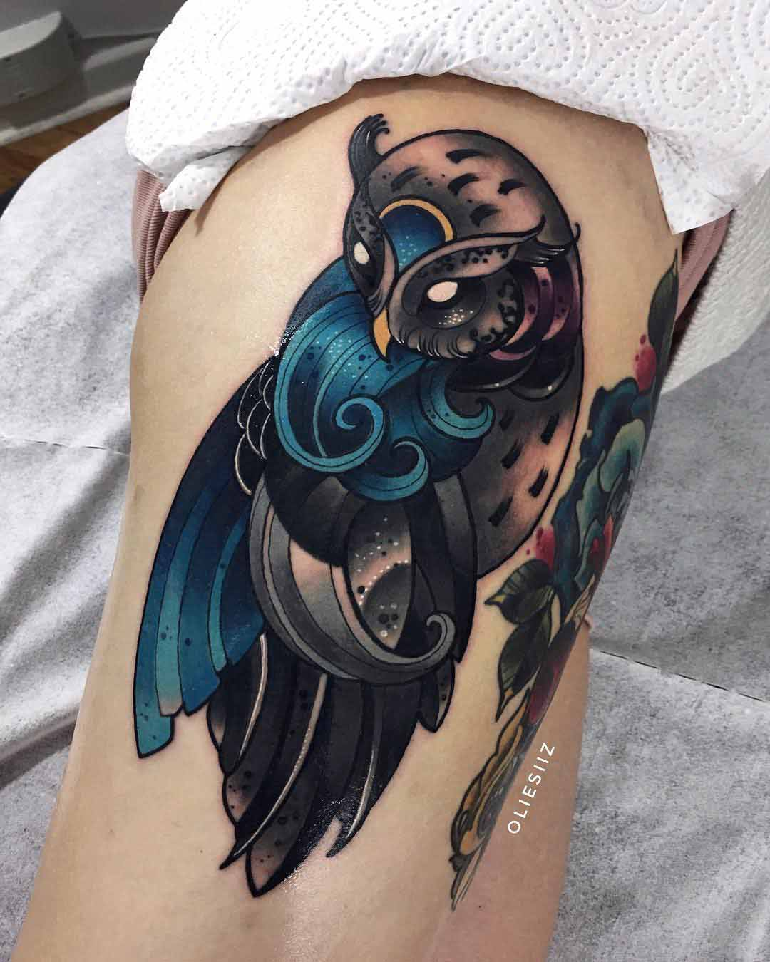 owl tattoo made of waves