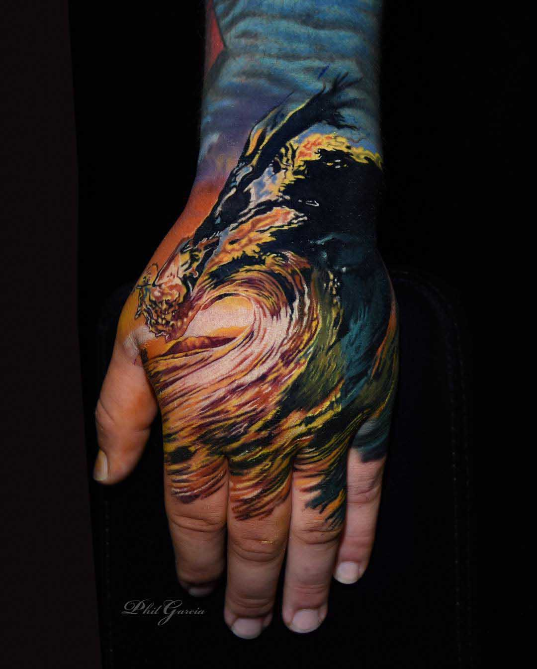 hand tattoo ocean wave