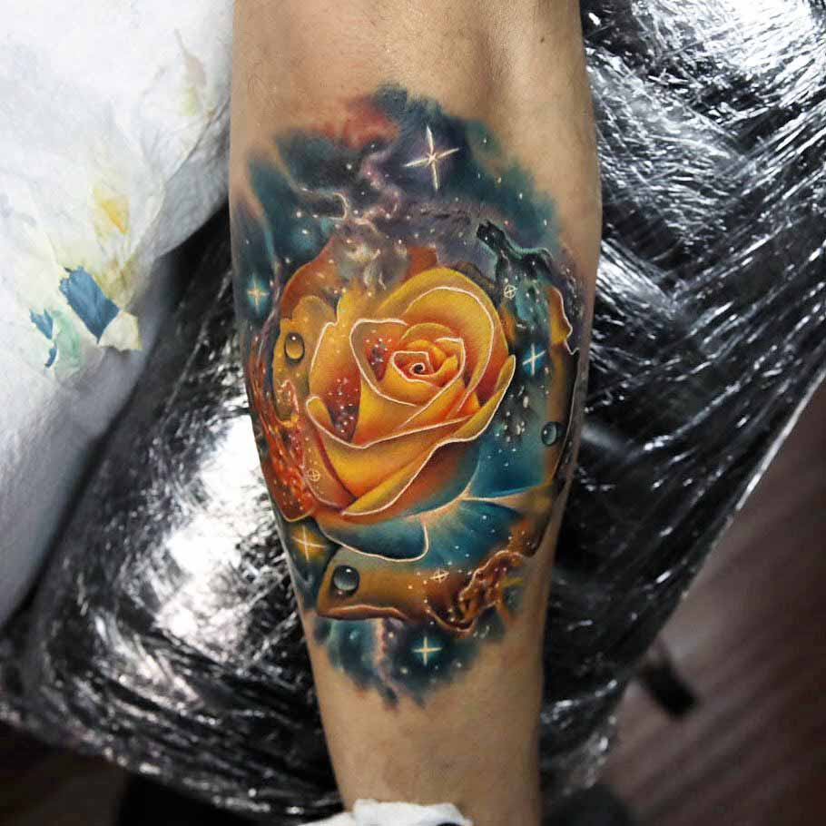 space yellow rose tattoo on arm