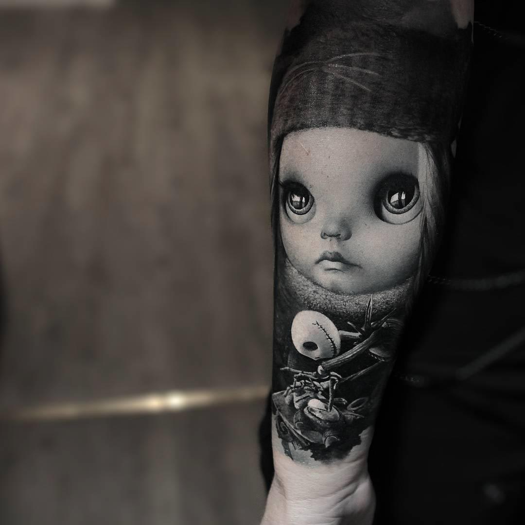 Jack and doll tattoo on arm
