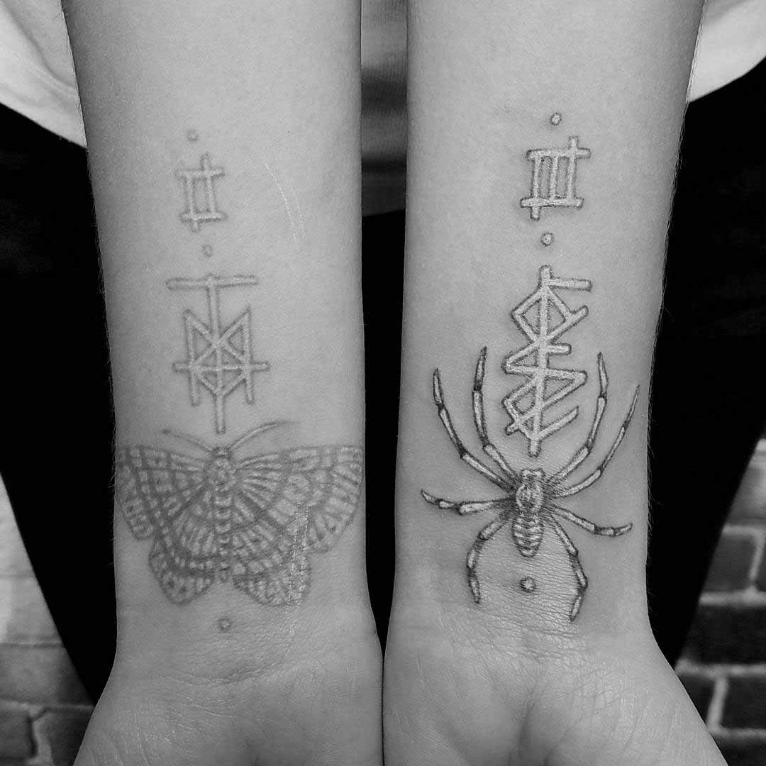 wrist tattoos spider and butter fly with white inks
