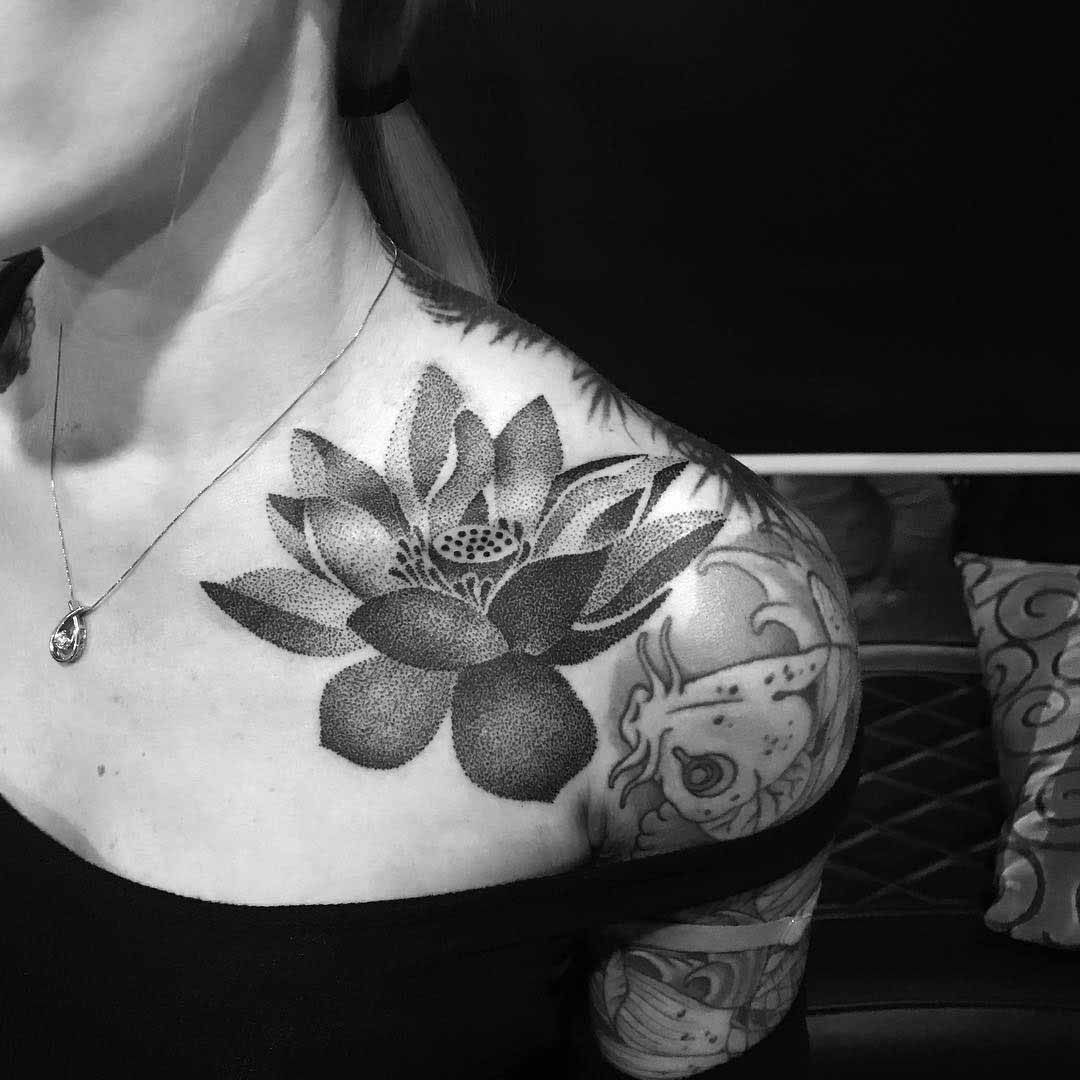 dotwork tattoo lotus flower on collar bone