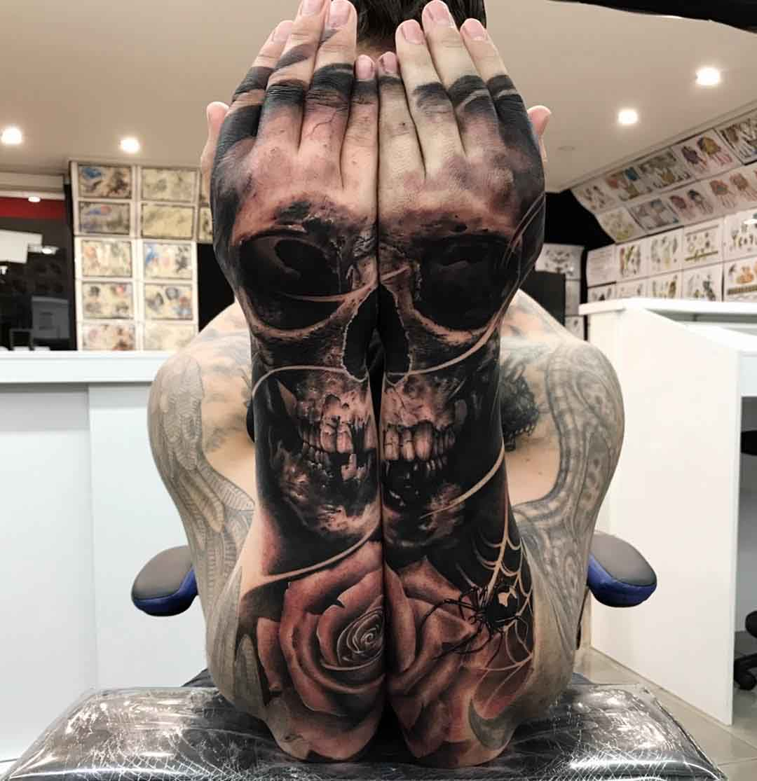 matching skull tattoo on forearms