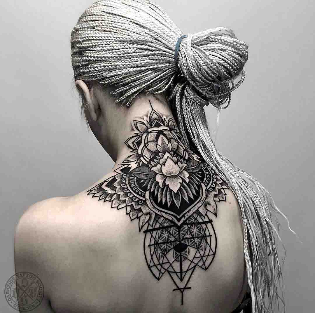 dotwork tattoo on back of neck