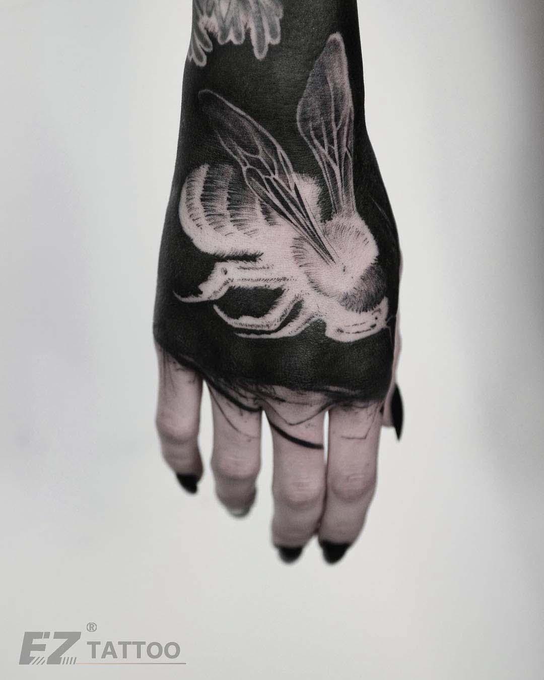 hand tattoo white inks bee