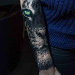 Black and Grey Lion Tattoo