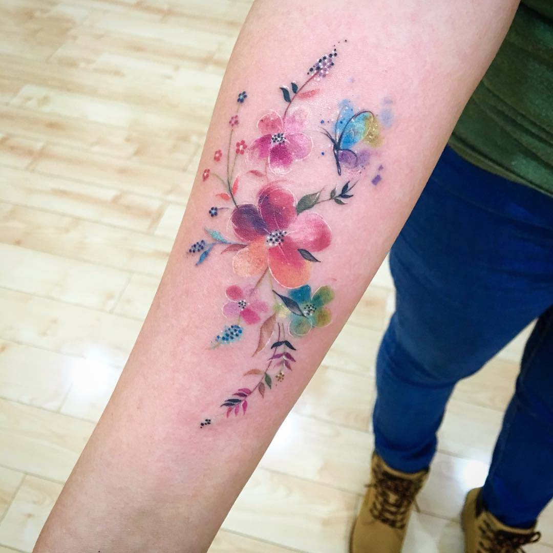 arm tattoo floral watercolor style