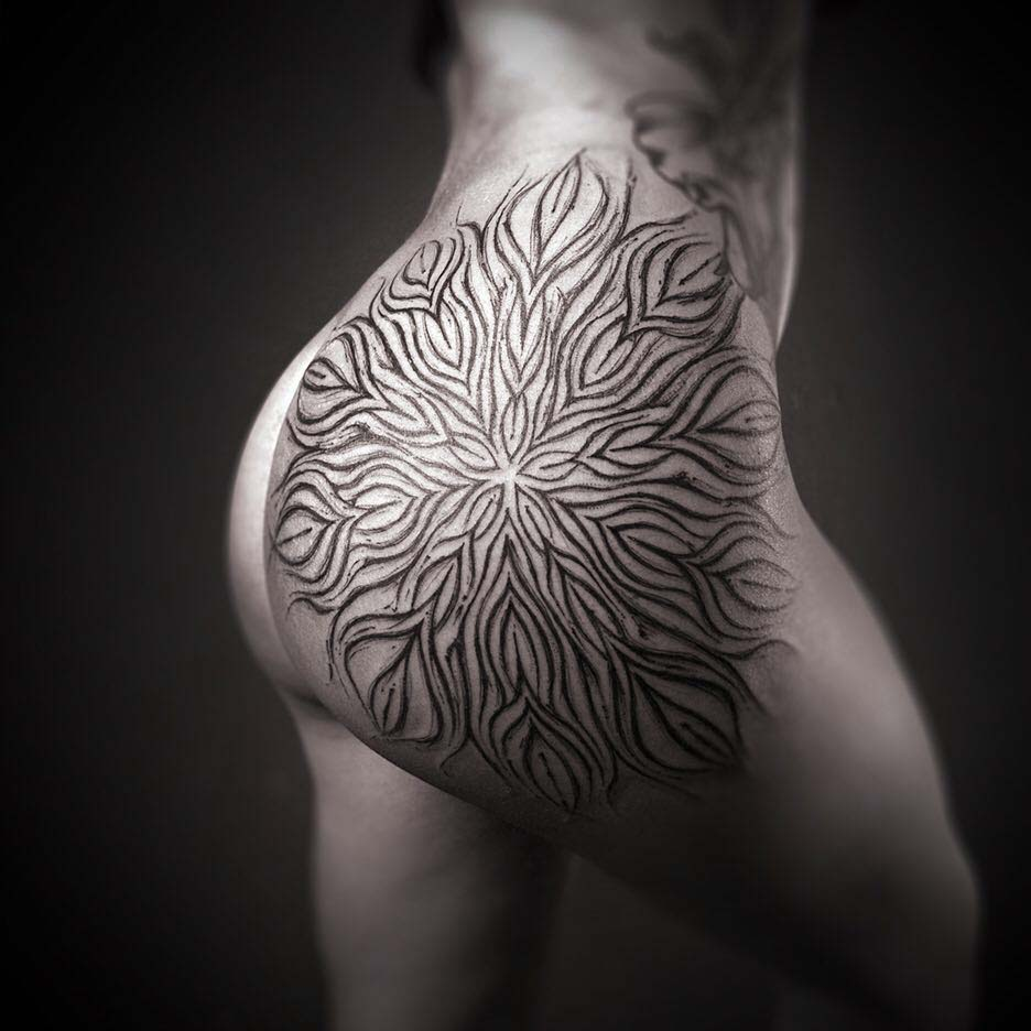 ornamental tattoo on hip