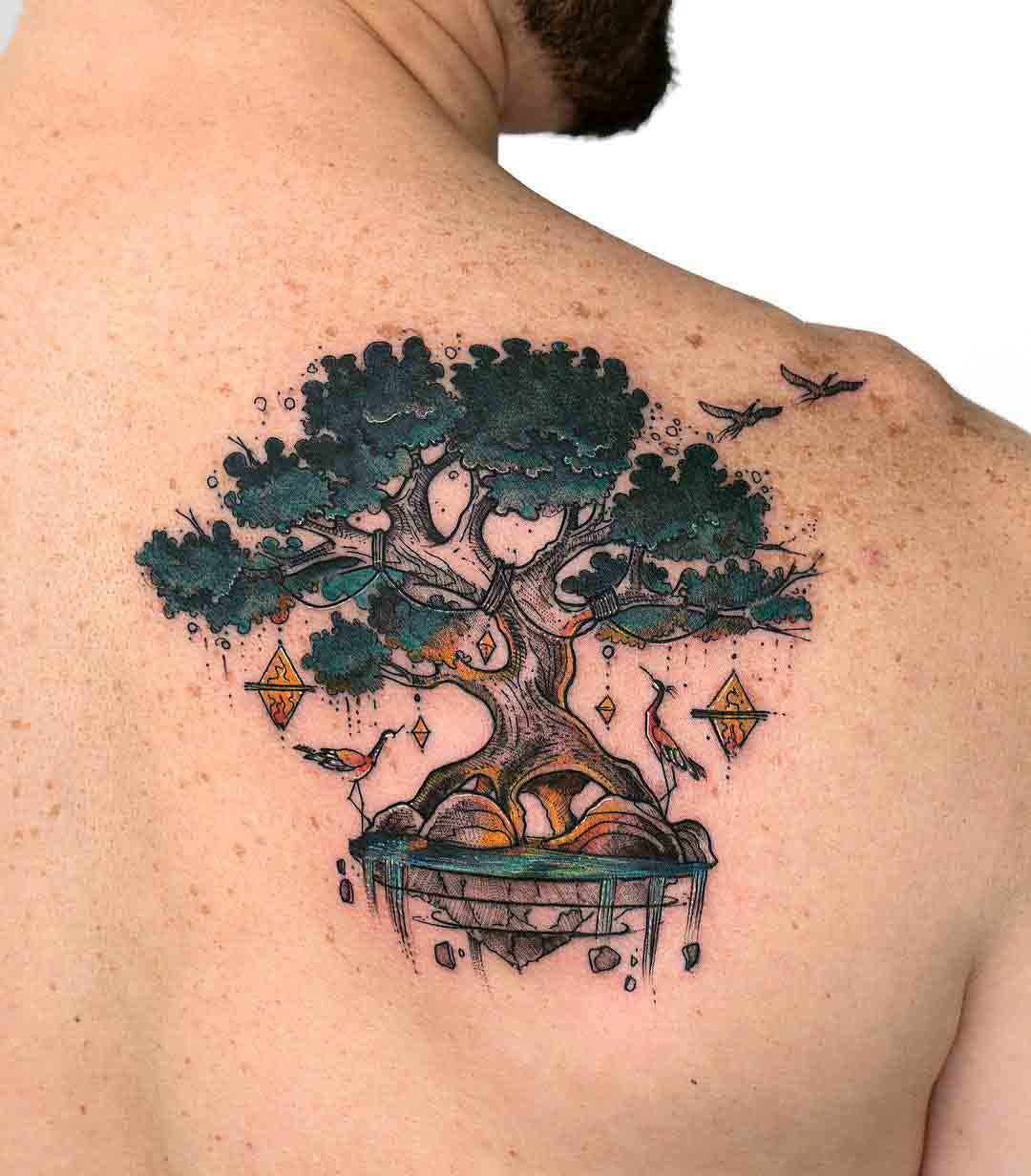 shoulder blade tree tattoo spiritual