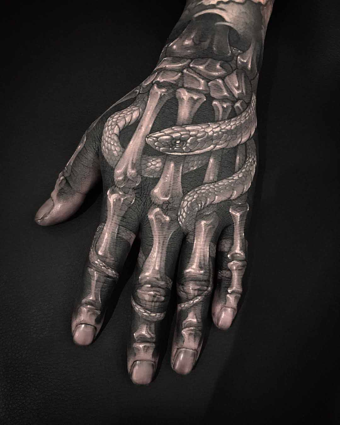 skeleton hand tattoo with snake