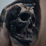 Shoulder Blade Skull Tattoo