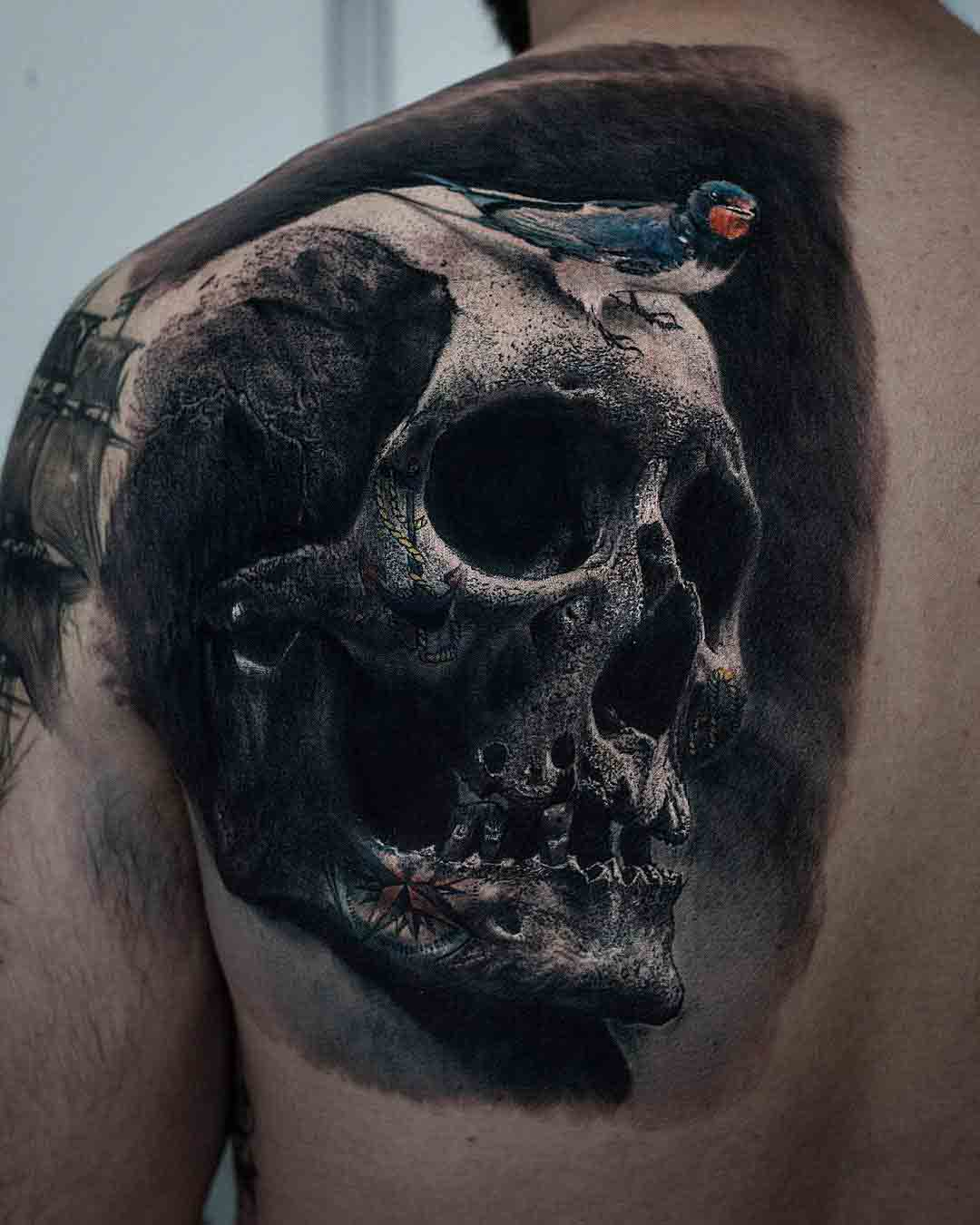 skull tattoo on shoulder blade