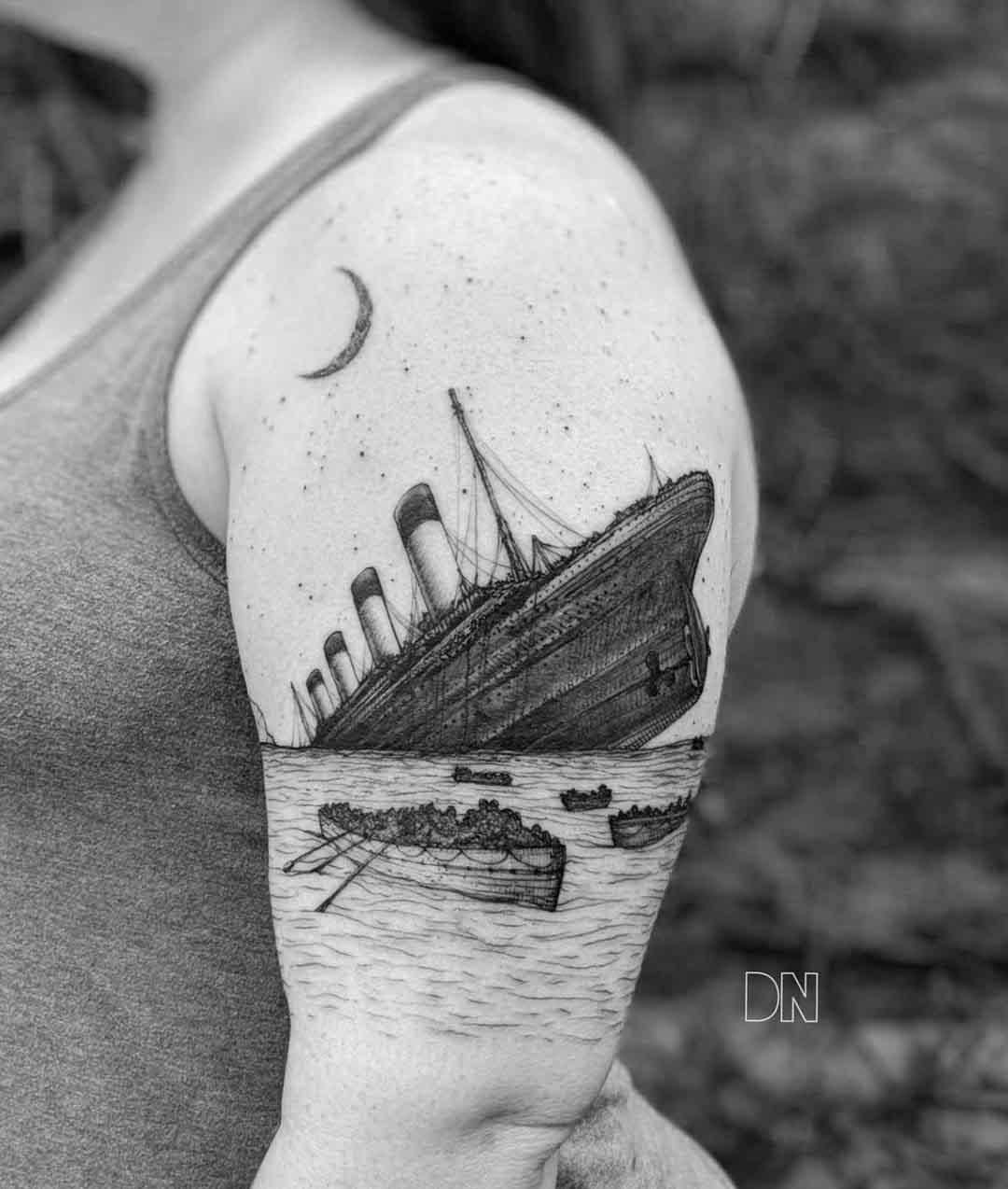 drawning titanic tattoo on shoulder