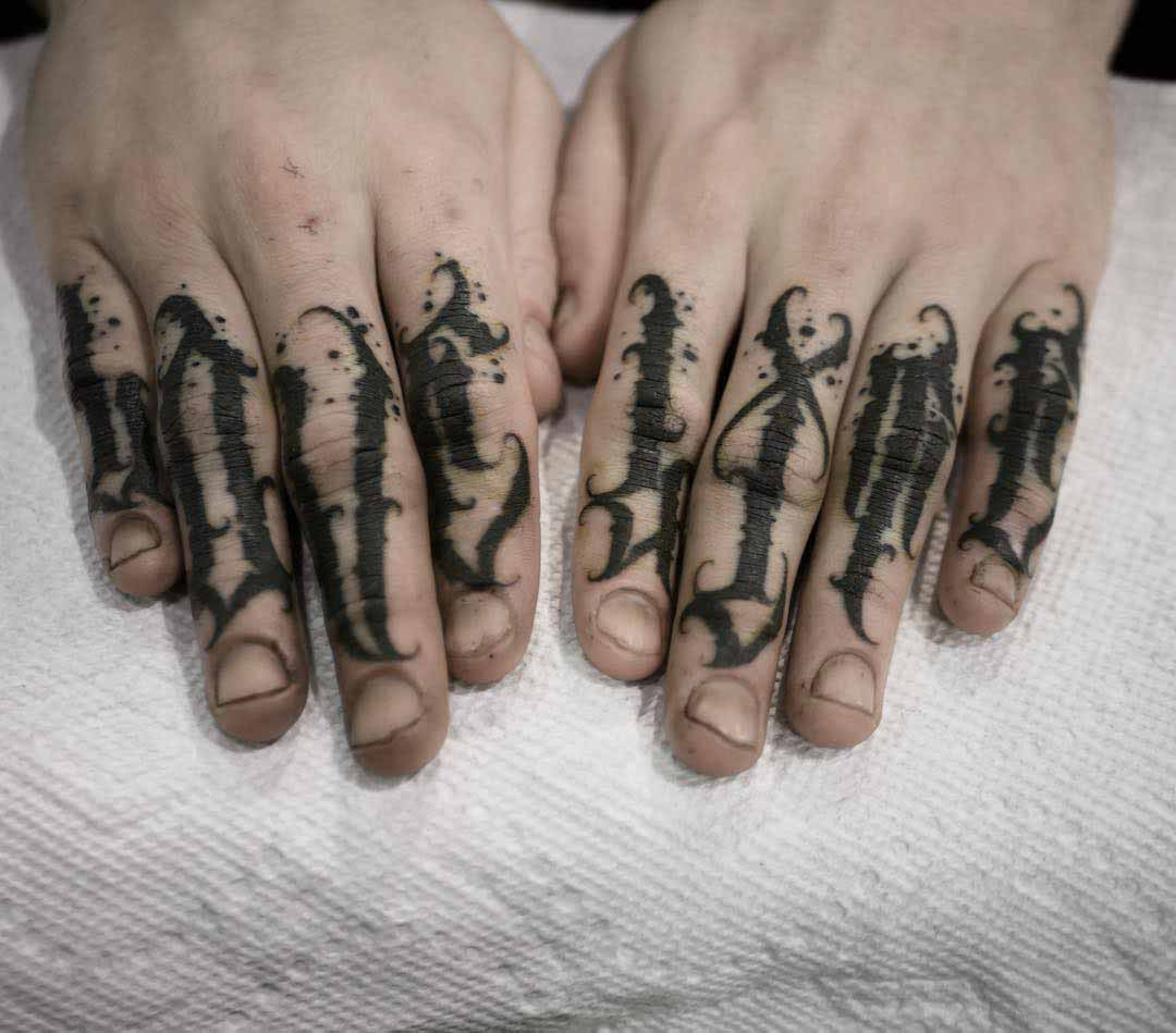 lattering tattoo on fingers love life