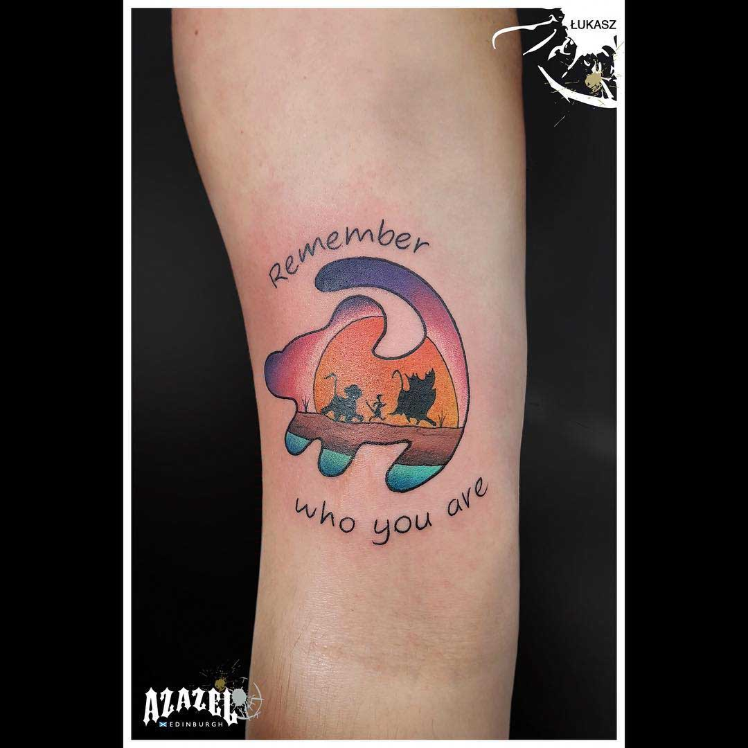 arm tattoo lion king emblem