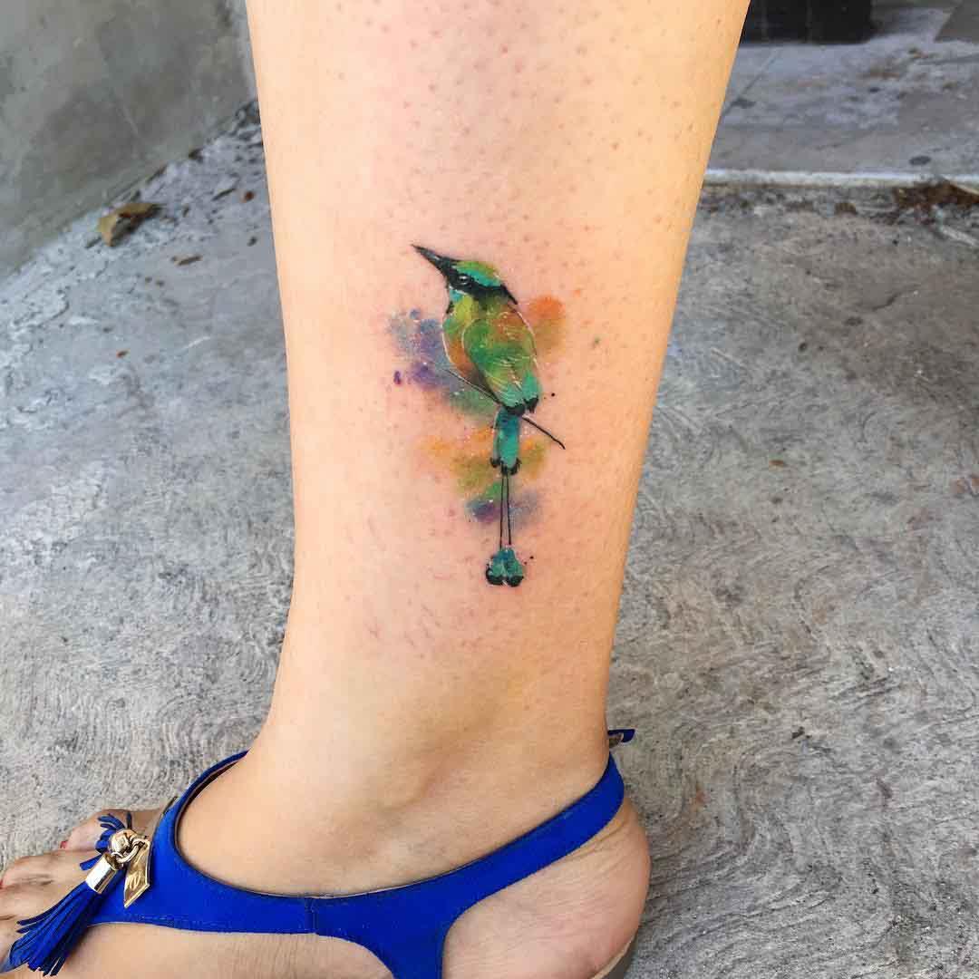 ankle tattoo small green bird