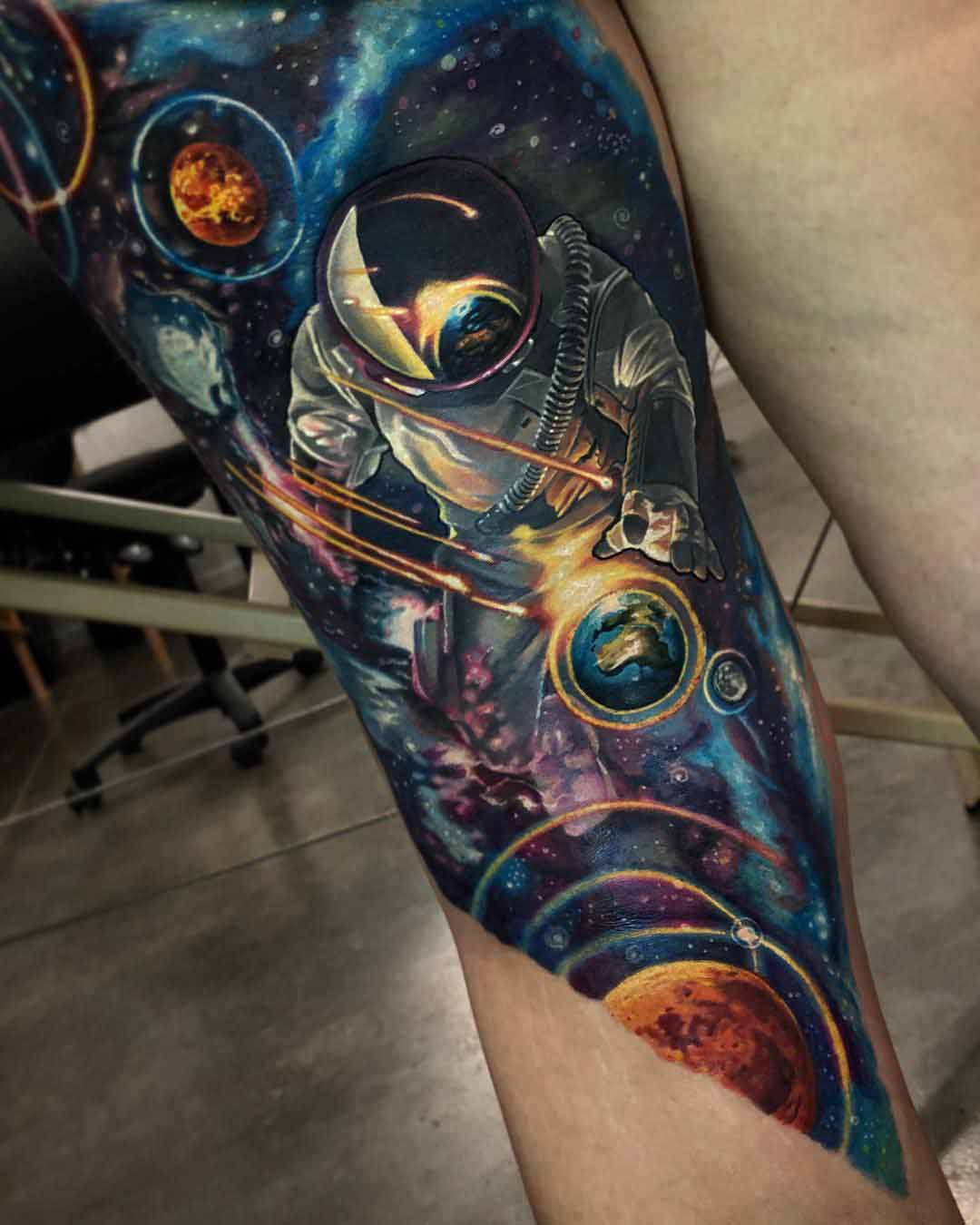 leg tattoo space astronaut