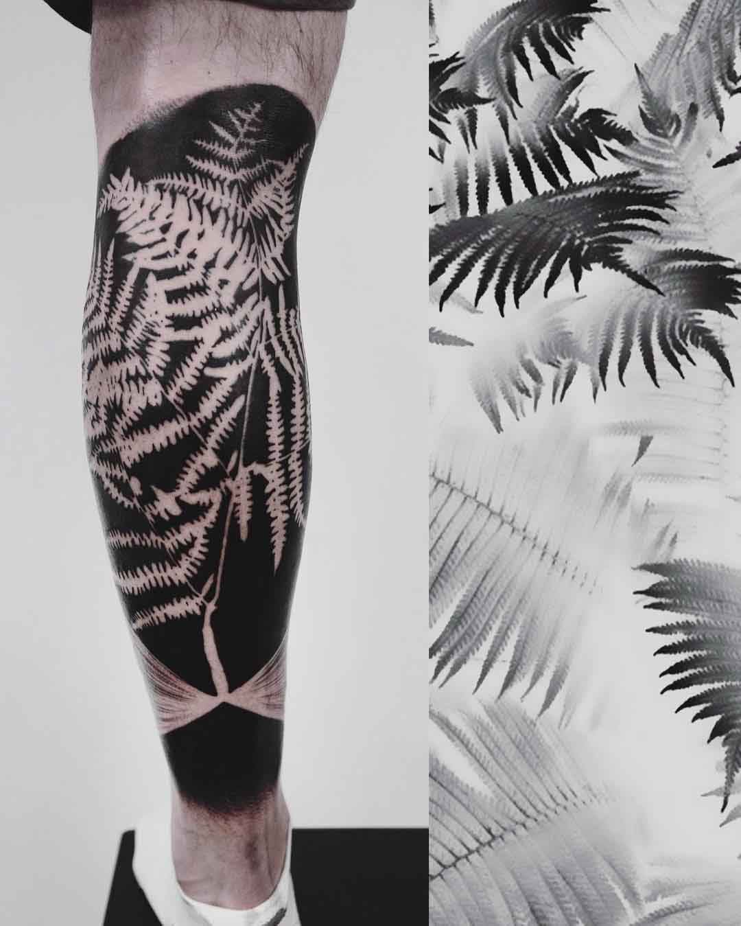 blackwork tattoo fern on calf