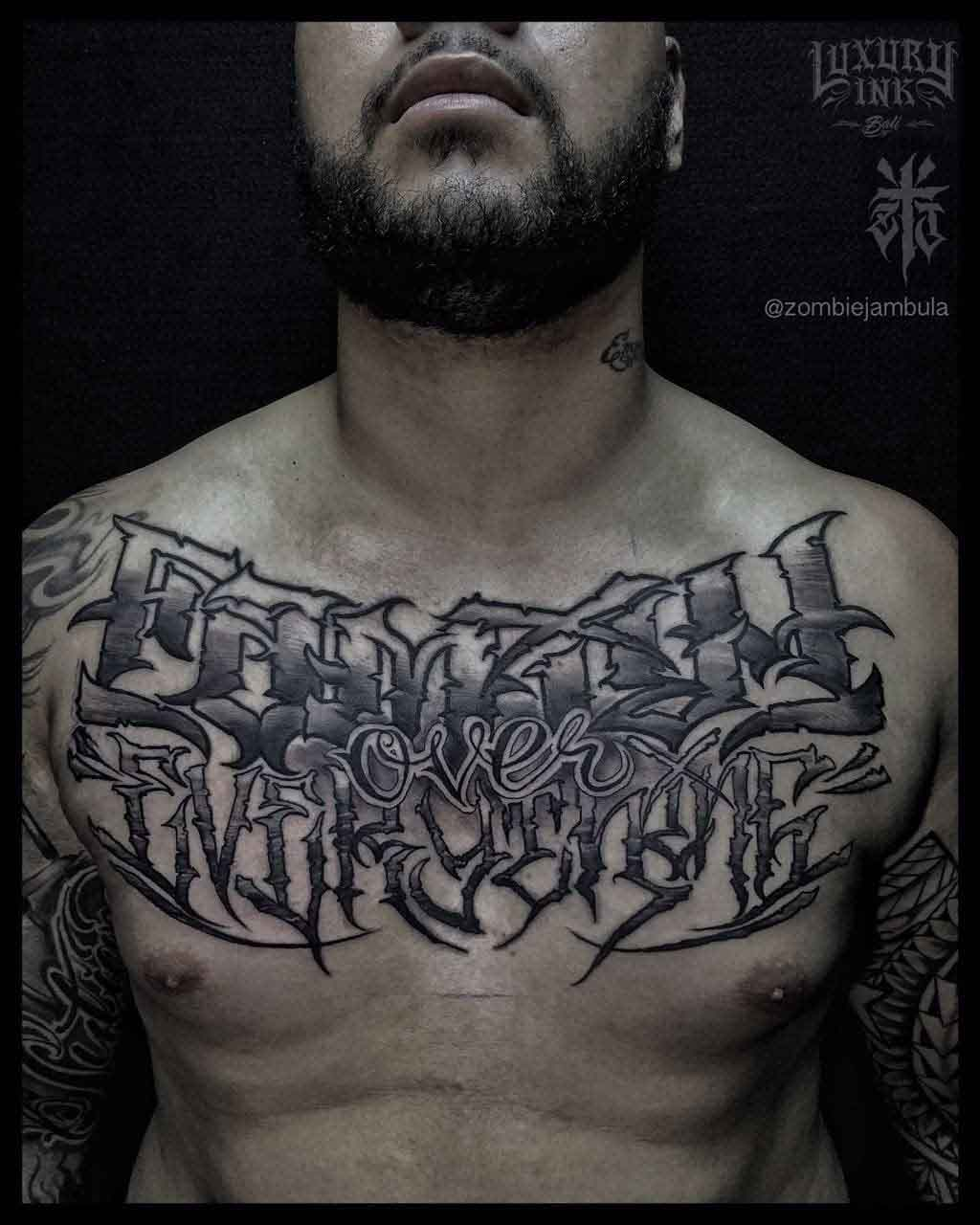 "chest tattoo lettering ""family ofver everything"""