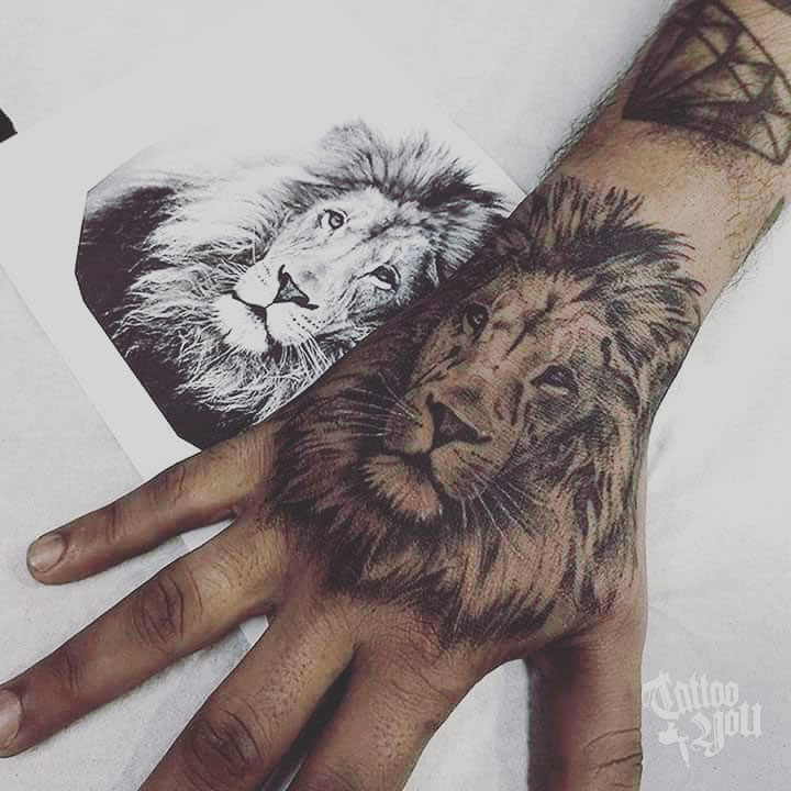 hand tattoo lion