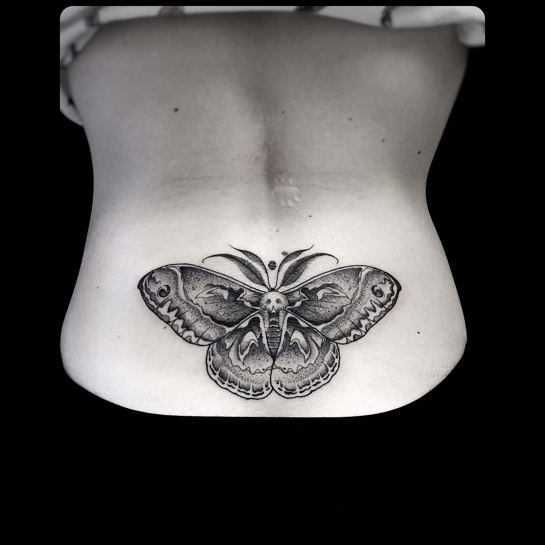 lower back tattoo moth