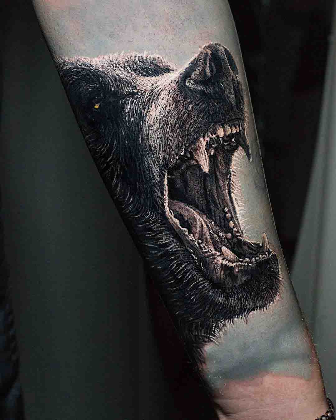 growling bear tattoo on arm