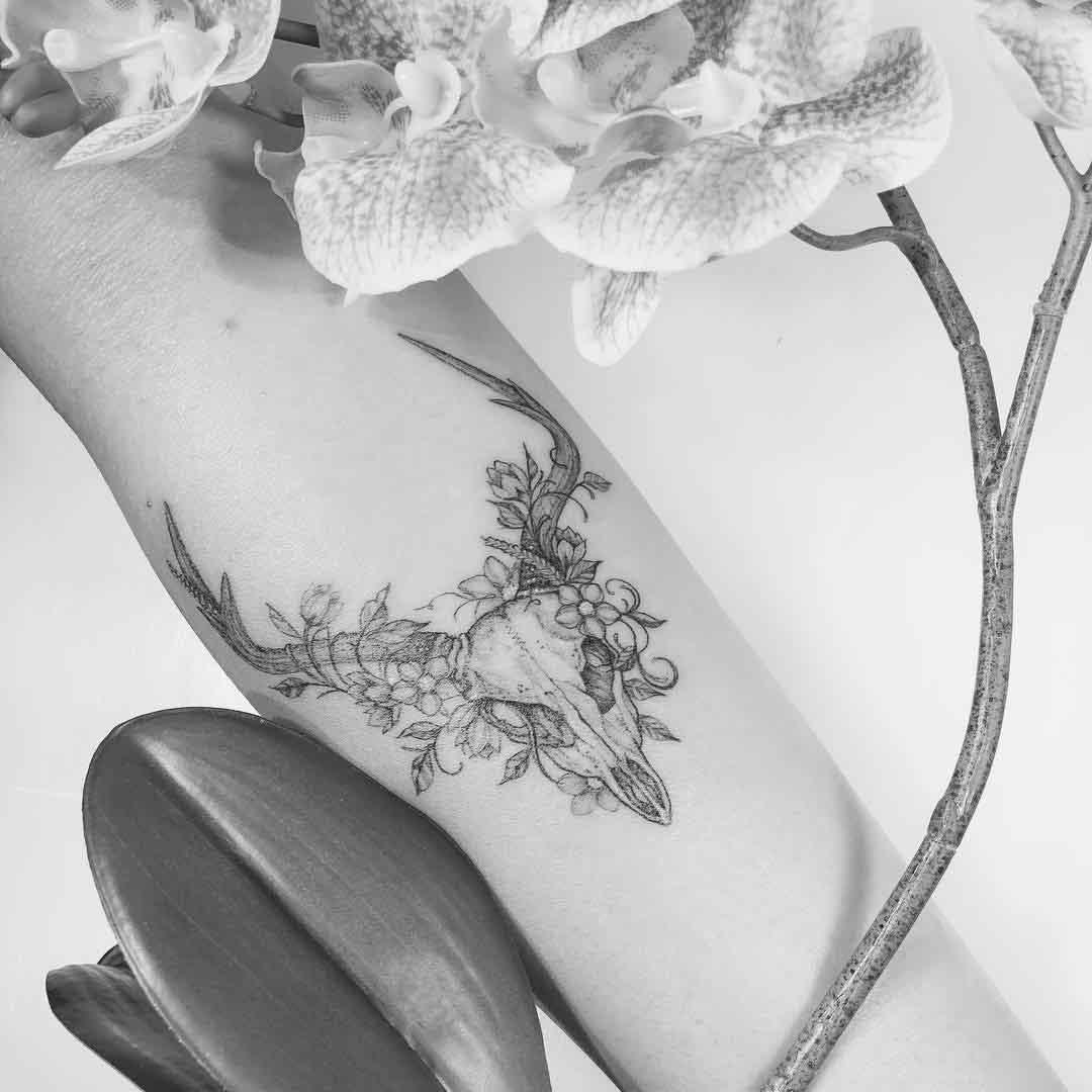 arm tattoo deer skull flowers