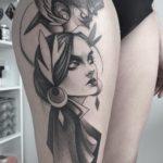 Girl and Bird Tattoo on Thigh