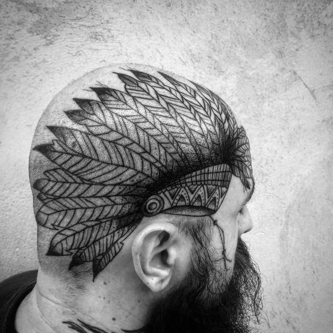 head tattoo feather