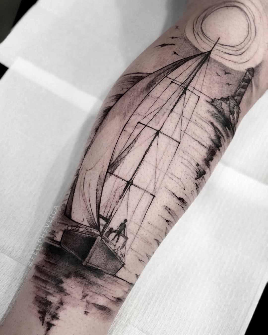 arm tattoo sailing sunset