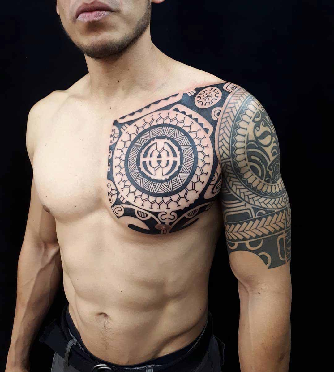 maori tattoo on chest and sleeve