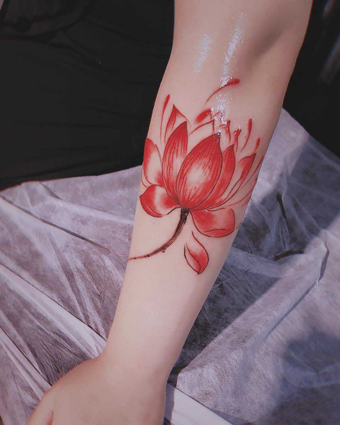 arm tattoo red lotus