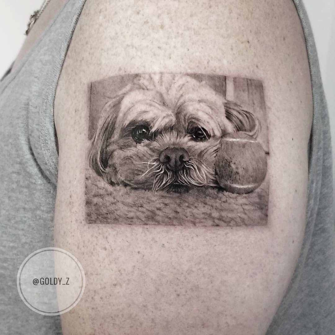 shoulder tattoo sad dog