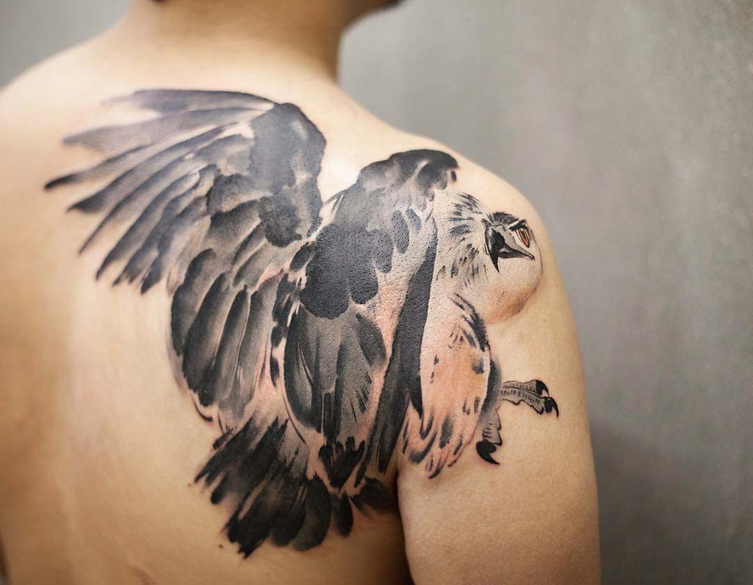 hawk tattoo on back of shoulder