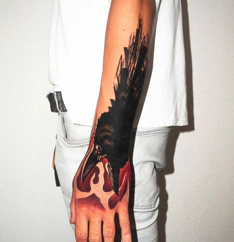 wrist tattoo crow