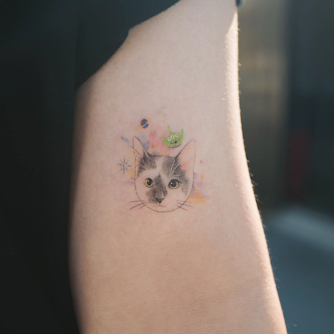 arm small cat tattoo