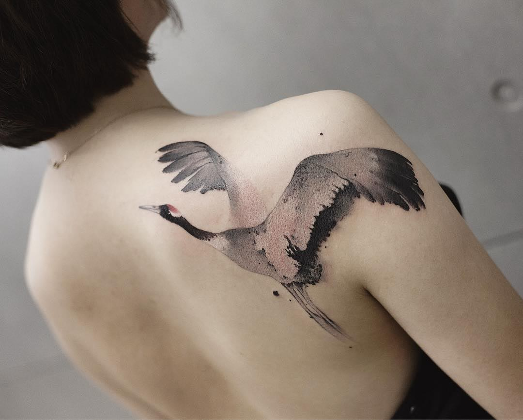 crane tattoo on shoulder blade