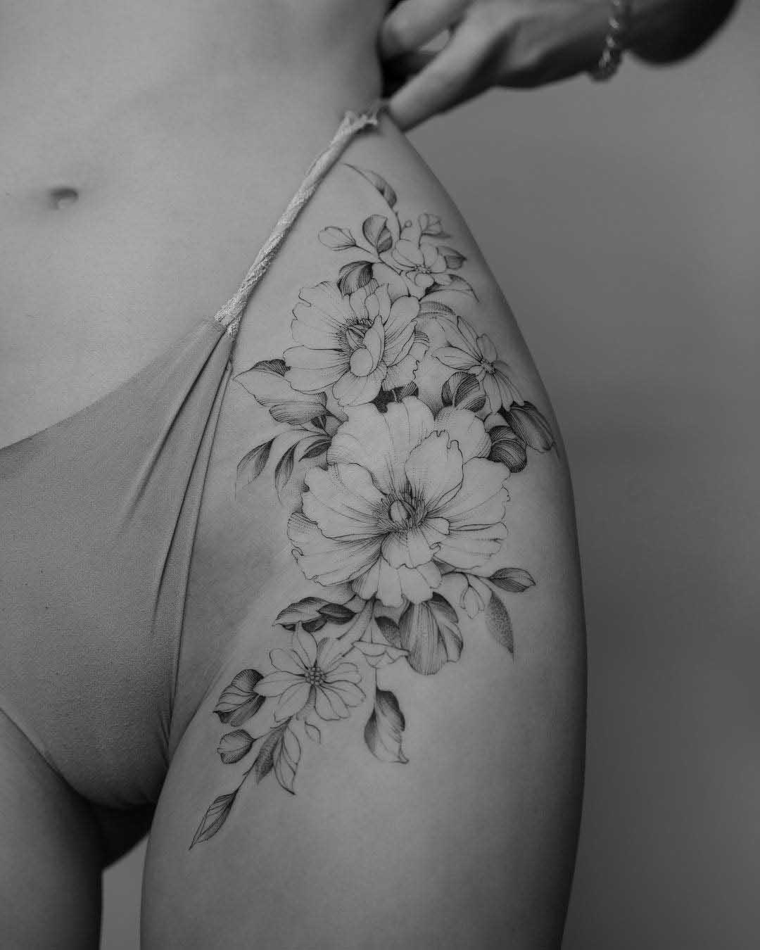 hip flowers tattoo ointimate