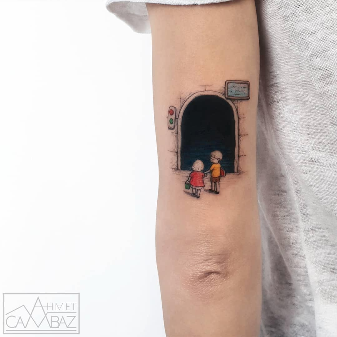 back arm tunnel tattoo