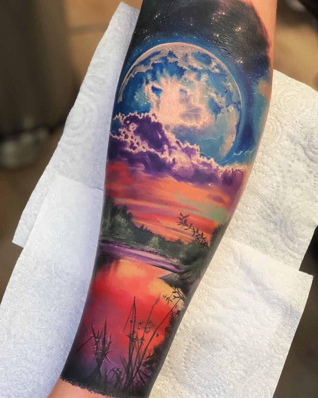sunset planet landscape tattoo