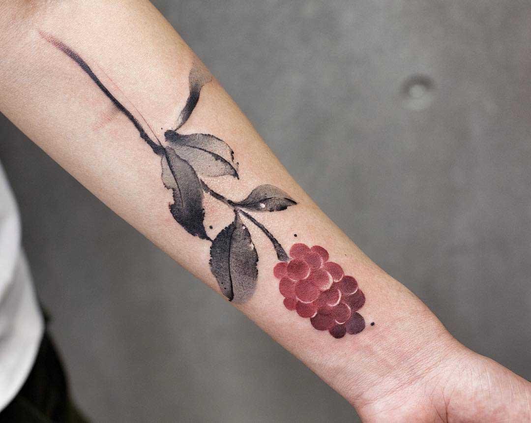 arm tattoo raspberry