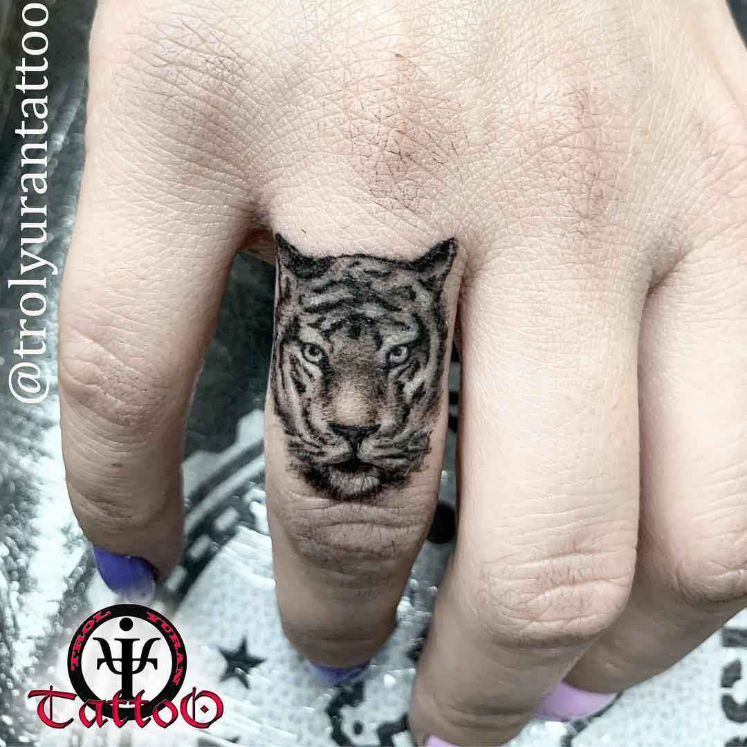 tiger tattoo on finger