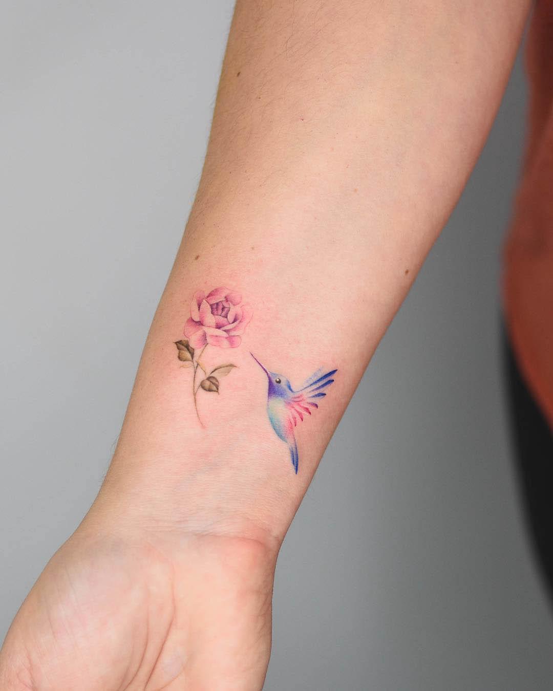 wrist tattoo hummingbird and rose